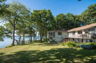 Sunny Shelter Island Waterfront With Dock And Sandy Beach