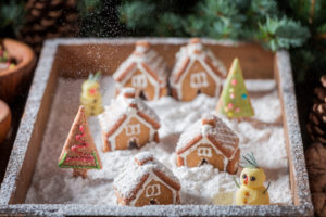 Cute and sweet Christmas gingerbread village with snowman and trees