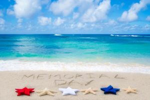 Memorial day background on the sandy beach near ocean